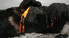 Spectacular dusk lava flow from a volcano into ocean suggest birth of planet. Stock Footage