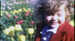 Little Girl Runs in Field of Flowers Circa 1960 (Vintage Film Home Movie) 1460 Stock Footage