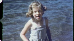 Laughing Little Girl At Beach WADING Shore 1960s Vintage Film Home Movie 1464 Stock Footage