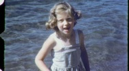Stock Video Footage of Little Girl Blue Dress At the Beach Circa 1960 (Vintage Film Home Movie) 1464