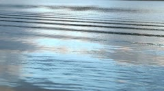 Waves and reflections from motorboat in a water 2 Stock Footage