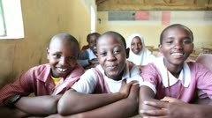 Smiling school children in classroom. Kenya, Africa. - stock footage
