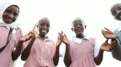 School girls and boys in uniform clapping hands and smiling at camera. Stock Footage