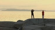 Stock Video Footage of Photographer at Peggy's Cove, Nova Scotia