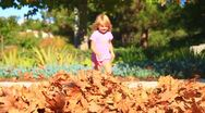 Kids run into Fall leaves3-MVI 6365 Stock Footage