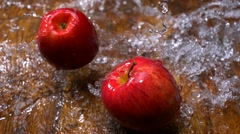 Apple and water splash, Slow Motion Stock Footage