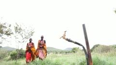 Two Maasai tribeswomen drinking clean water. Kenya, Africa. Stock Footage