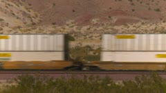 Railroad, BNSF container train in the desert, through frame, tight shot Stock Footage
