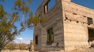 Stock Video Footage of long abandoned and forgotten house in the desert wide static