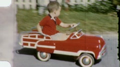 LITTLE BOY DRIVES PEDAL CAR Plays Rides 1960s Vintage Film Home Movie 1479 Stock Footage