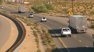 Transport trucks on curve, desert highway Stock Footage
