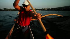 A man rows an outrigger canoe fast. Stock Footage