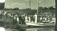 Stock Video Footage of Small boats and crowd at pier Circa 1935 (Vintage Film Home Movie) 1488