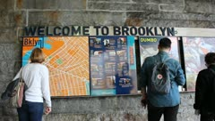 Tourists Looking at Brooklyn Bridge Map Stock Video - stock footage
