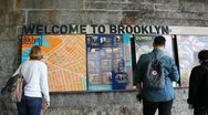 Tourists Looking at Brooklyn Bridge Map Stock Video Stock Footage