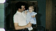 Stock Video Footage of Father With Baby Dad Holds Daughter 1950s Vintage Film Home Movie Footage 1497