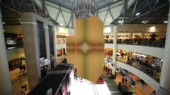 Shimmering cubes hangs from the ceiling, in high-rise shopping center Stock Footage