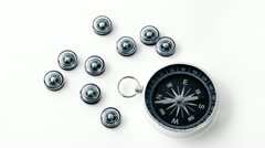 Nine small black plastic compasses and one big isolated Stock Footage