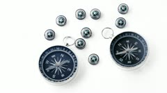 Nine small black plastic compasses and two big isolated - stock footage