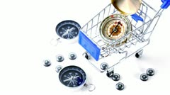 Nine small black plastic compasses in little shopping cart Stock Footage