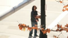 Man playing an instrument on the street corner Stock Footage
