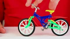 Boy play with toy bike Stock Footage