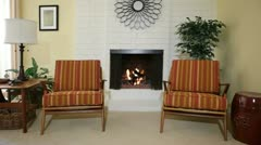 Chairs next to fireplace in Living Room of Home Stock Footage