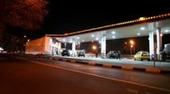 Stock Video Footage of Several cars fill fuel at gas station in city at night