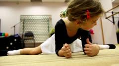 Girl stretches under surveillance of ballet teacher Stock Footage
