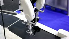 Robotic prosthetic legs moves above working racetrack Stock Footage