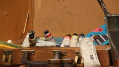 Box full of painting supplies Stock Footage
