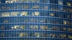 Numerous offices behind windows of an office building Stock Footage
