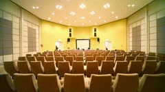 Few people sit on conference hall Stock Footage