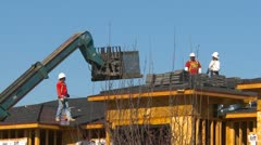 Construction, lift delivers roof tiles Stock Footage