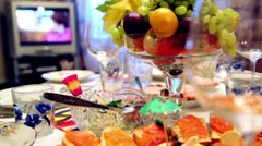 Bowl of fruit and different snacks on the table Stock Footage
