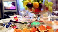 Stock Video Footage of Bowl of fruit and different snacks on the table