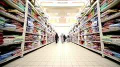 Many goods are on shelves in store Stock Footage