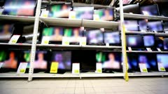 Many tv sets stay working on showcase in hypermarket Stock Footage