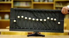 Many use old equipment with balls on ropes for demonstration waves at school Stock Footage