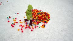 Little girl run around pile of colored balls at winter Stock Footage