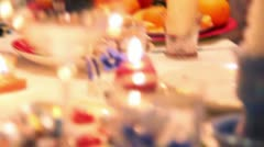 Candles and glasses on decorated christmas dining table Stock Footage