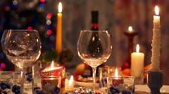 Christmas dining table with bottle, glasses, candy, candles Stock Footage