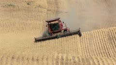 Combine tractor and wheat rows Stock Footage