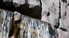 Waterfall streams from cave in wet rocks Stock Footage