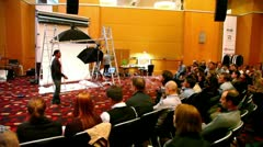Man answers question on photography lesson at conference STOCKinRUSSIA 2010 Stock Footage