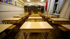 Rows of chairs and tables inside empty physics school class - stock footage