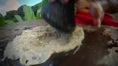 Poi paste is ground on a pestle ion hawaii. - stock footage