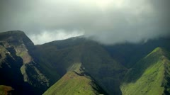 Clouds move over rainforest in Hawaii. - stock footage