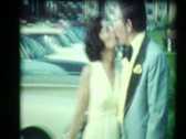 Stock Video Footage of Formal 70's Couple Kisses