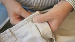 man sewing button - stock footage